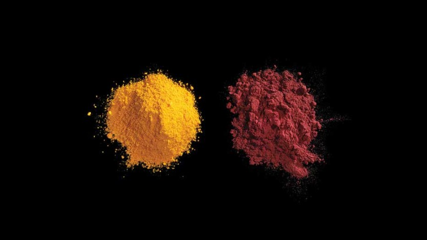 Artificial dyes Red No. 40 and Yellow No. 5 They start out as grey and white powders that include nitric acid and tartaric acid. Then they're mixed with petroleum byproducts, neutralized with lye, and sprayed as a mist onto hot walls to instantly dry the mixture into these brightly-colored powders. Dwight Eschliman/Regan Arts