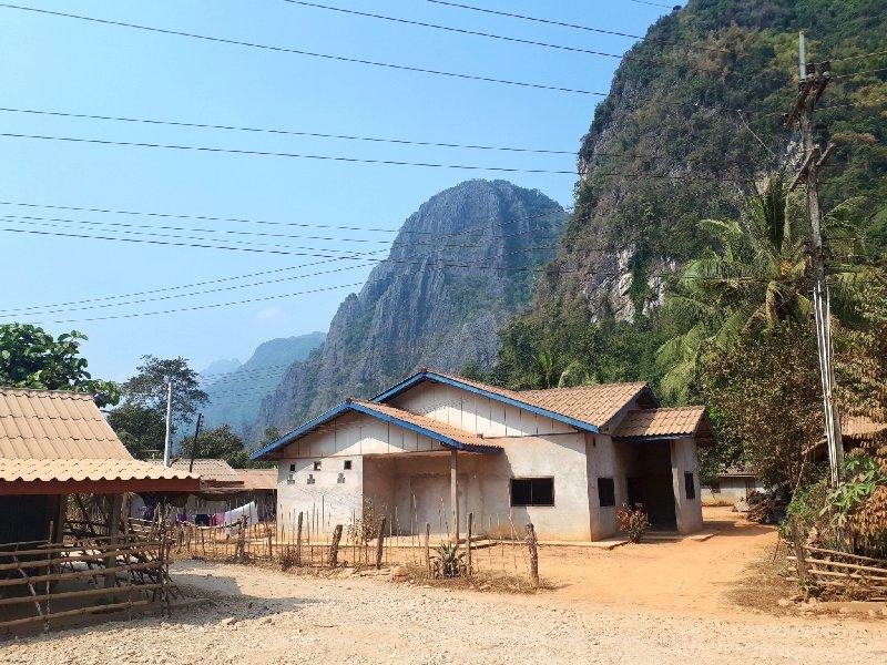 limestone cliffs village laos