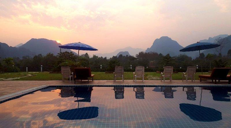 sunset vang vieng simon riverside hotel laos