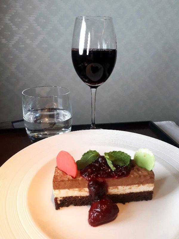 dessert cheesecake garuda business class wine food meal review