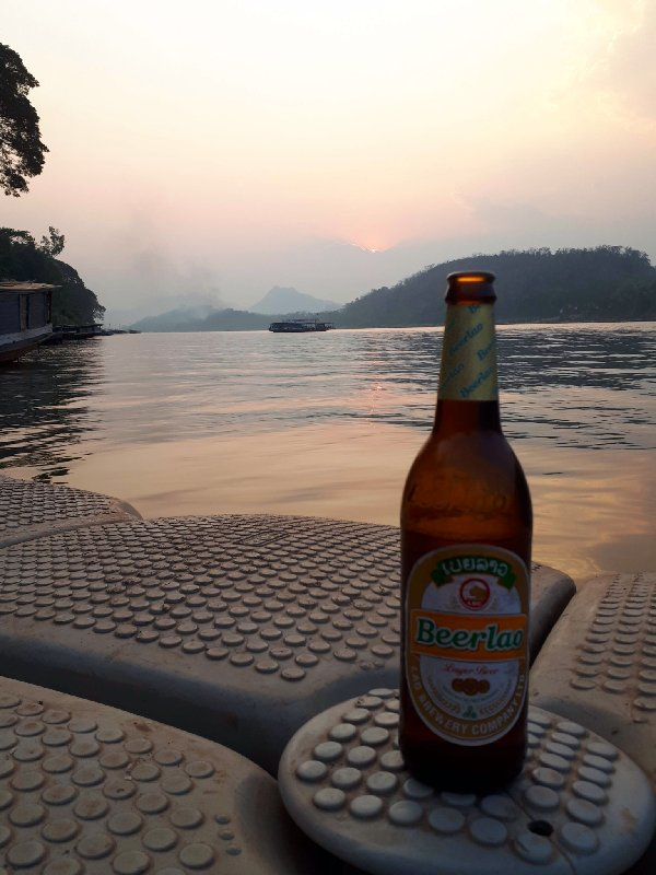beer lao sunset mekong