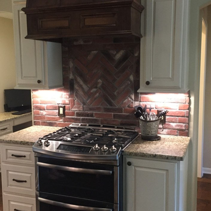 Kitchen stove and brick backsplash