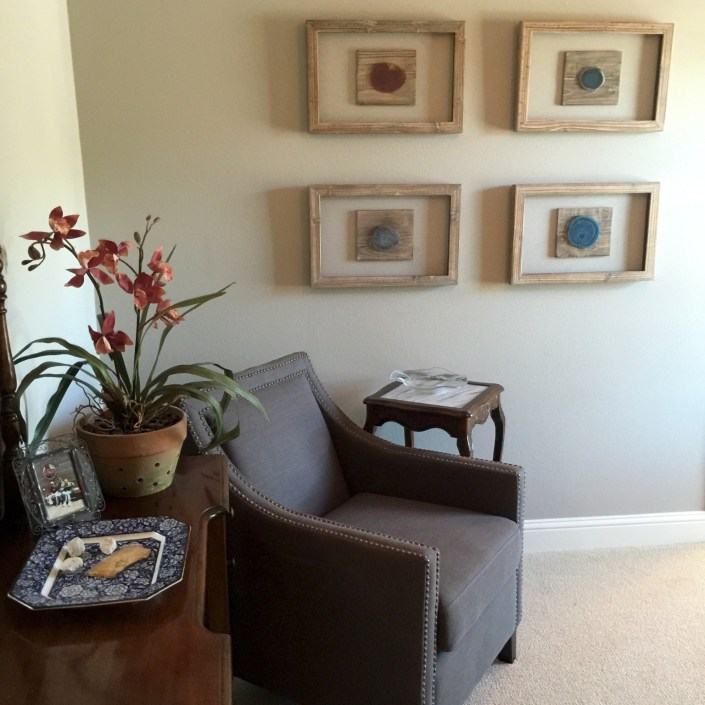 Reading chair with eclectic wall art