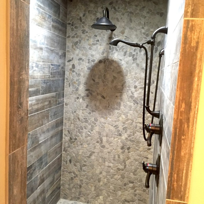 Rustic shower with stone mosiac tile