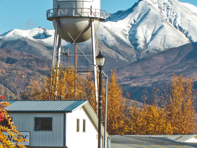 Water Tower in Palmer, Alaska with Matanuska Peak and Lazy Mountain in the background, in autumn