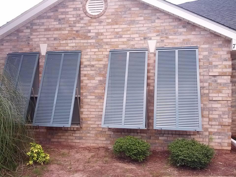 Bahama Shutters For Garage Windows On Brick Home