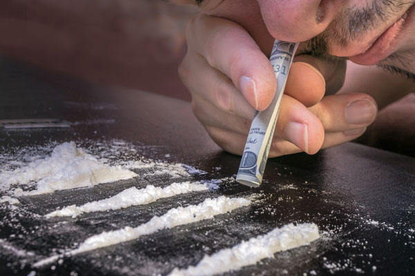 man snorting heroin