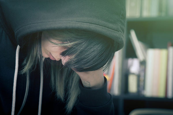 woman going through withdrawal symptoms of depression from opioids