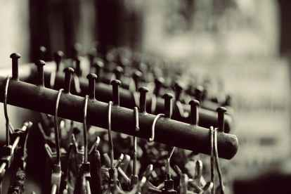 grayscale photography of hangers on rack