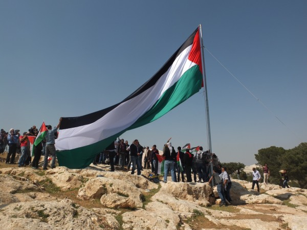 Huge Palestinian flag is erected directly across from Maale Adumim settlement