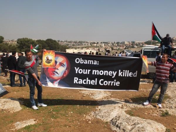 Demonstrators hold up sign made for Obamas visit