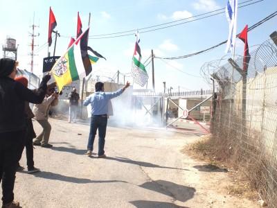Stun grenades are thrown at demonstrators outside an Israeli military base