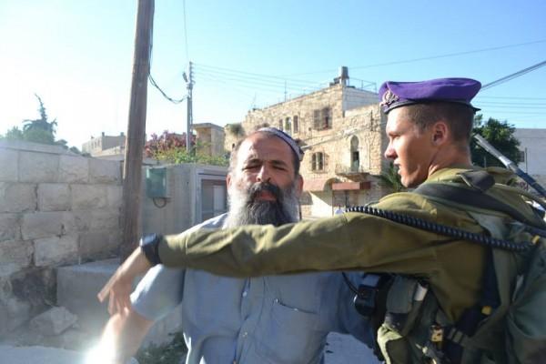 Settler tries to attack international observer