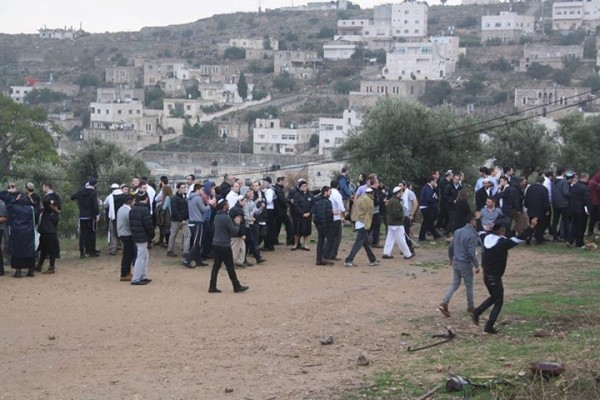 Illegal Israeli settlers celebrating the takeover of Palestinian homes by Israeli forces Photo credit: Youth Against Settlement