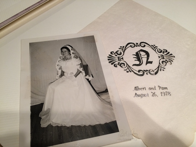 Pam posing and napkins from thirty-eight years ago.