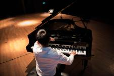 back-view-photo-of-a-man-playing-a-black-grand-piano-2378209