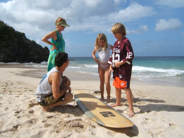 My husband teaching Clark Kent, Susanne, and me to surf.