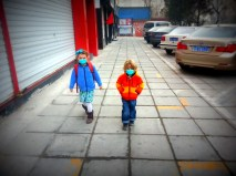 Sophia and Dylan walking to school on a polluted morning