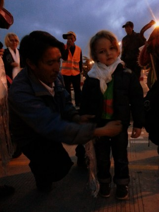 Our friend and guide, Pemba Tashi, greeting Dylan with a khata (white ceremonial scarf)