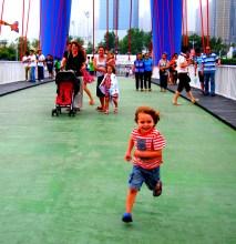 Running across a bridge, Xinghai Square area