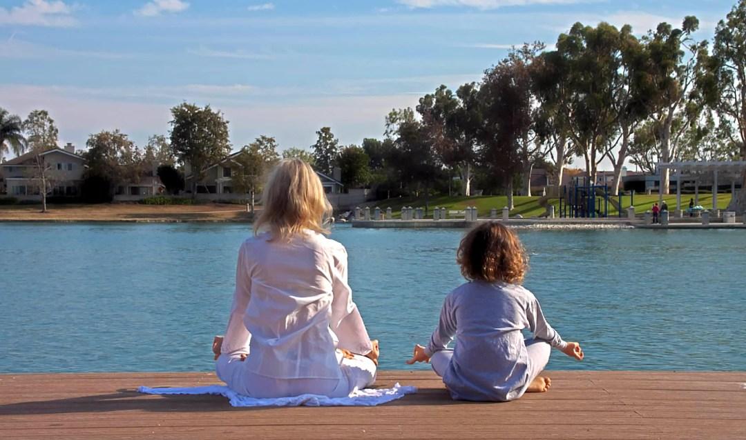 Pamela Winslow Kashani and her son Timothy meditating