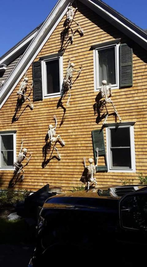 skeletons climbing on house