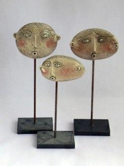 3 ceramic heads in sticks