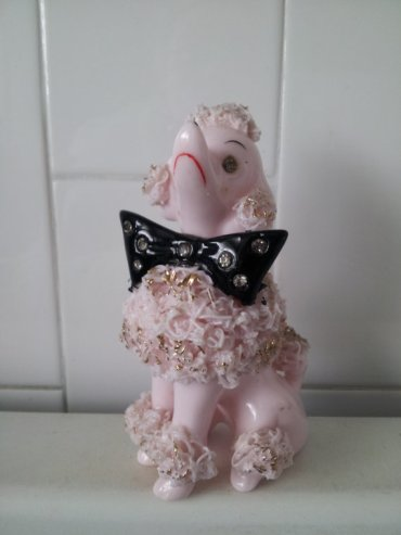 Pink ceramic poodle with bow tie