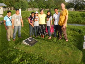 Paying respects to at the grave of Pastor Chito after visiting the Sorsogon Pier