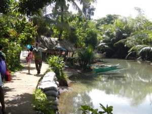 One gets to the Capuy outreach by walking along a pathway next to a stream/inlet that connects to Sorsogon Bay.  Most people that live here are fishermen.