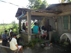 The Capuy outreach includes an adult Bible study in the veranda of this house, while the children meet in an open air cottage a block away.