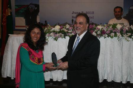 President Iqbal Walji presenting an award to Samina Baig