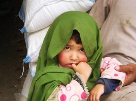 A Balti baby girl at a roadside shop