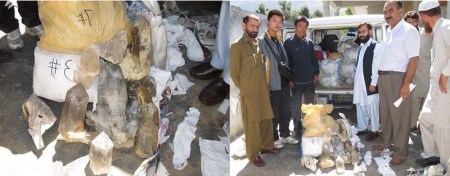Officials posing with the recovered minerals and the Chinese citizens