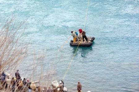 Local volunteers search for bodies in the icy cold Ghizer River. PT Photo