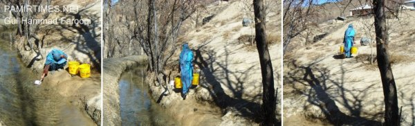 A woman carrying water in two buckets in the Bakarabad village of Chitral