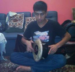 Nizamuddin playing an instrument during one of his sessions