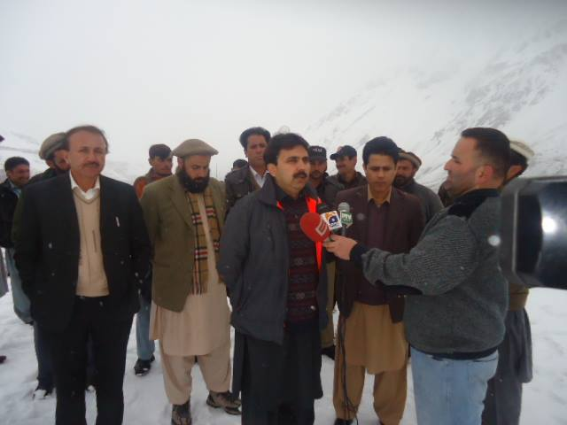 Secretary Health and DC Ghizar talking to media in Phandar. Photo: Raja Adil Ghias