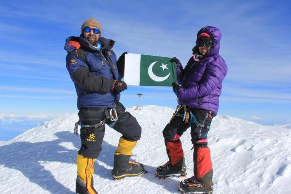 Mirza and Samina holding the Pakistani flag on top of Mt. McKinley