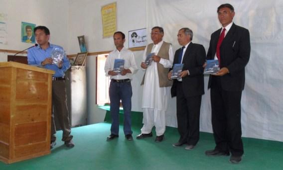 Gulmit: Chief Guest Gul Baig, MLA Mutabiat Shah, Sharif Khan President RC Hunza and Nazir Ahmed Bulbul showing the book to the audience during the launching ceremony.