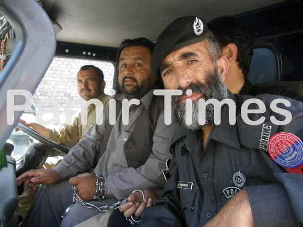 Baba Jan is being taken to jail in a police vehicle