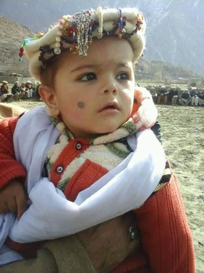 A child prepared for the occasion in Ghulkin village