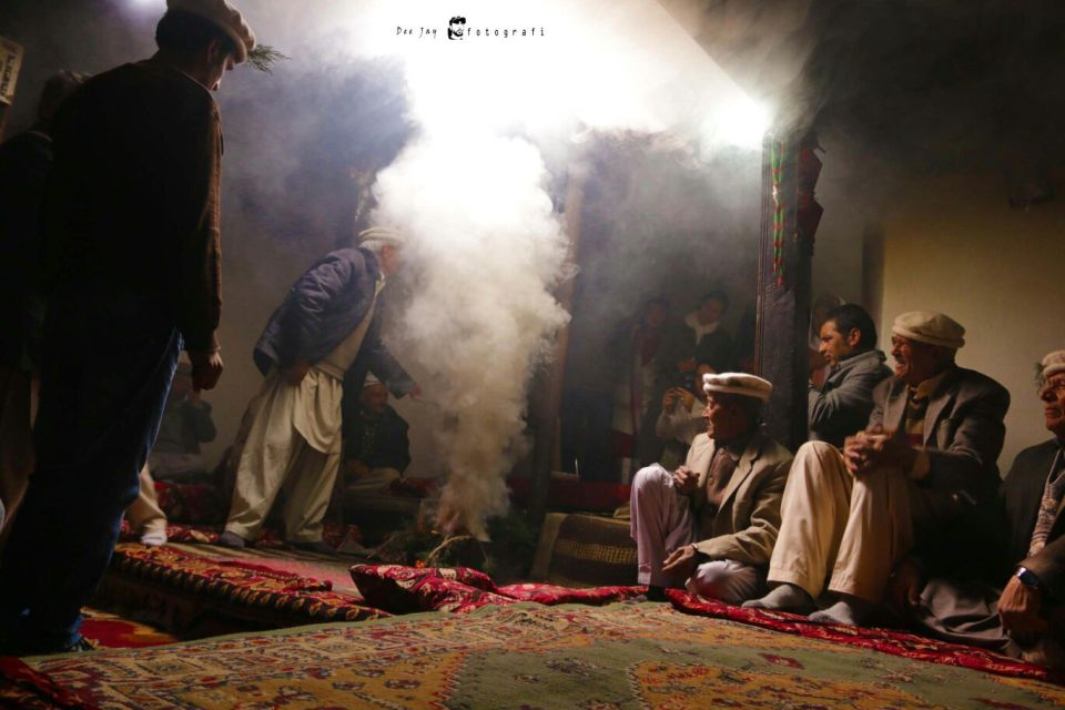 Yarz is being burnt inside a traditional house creating clouds of smoke. This process is calling Thumang. Photo: Deedar Ali