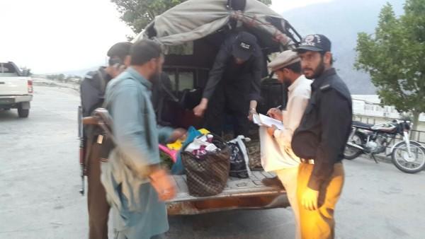 Belongings of the passengers can be seen in a police vehicle. Photo: Mujeebur Rehman