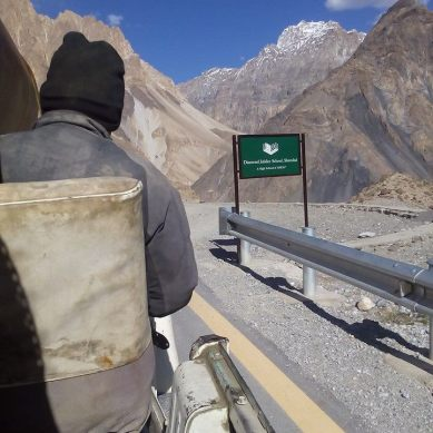 Transporting huge pipes for a hydropower project, on a shabby jeep, to the Shimshal Valley
