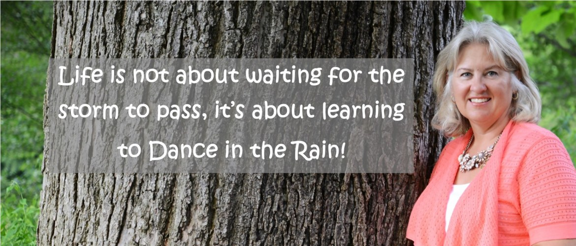 "Pam standing by tree ""Life is not about learning to dance in the rain!"""