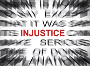 Blured text with focus on INJUSTICE