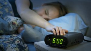 daylight-savings-woman-alarm-clock-300x169