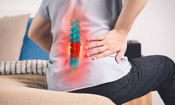 bigstock-Pain-In-The-Spine-A-Man-With--264256387