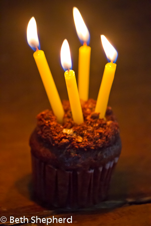 Four candles in a cupcake